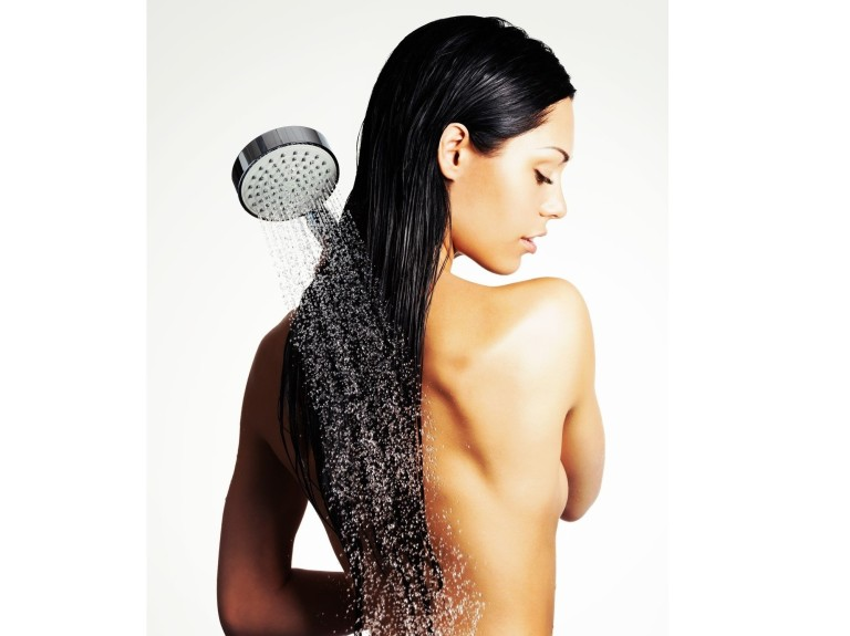 Photo of a woman in shower washing long hair